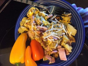 White sweet potato, ham, and egg scramble with cheese and raw mini peppers